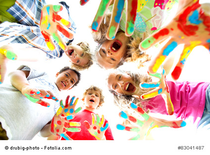 smiling kids with colourfull hands
