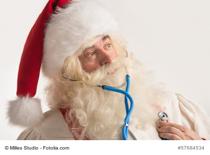 Santa Claus Doctor using a stethoscope on himself
